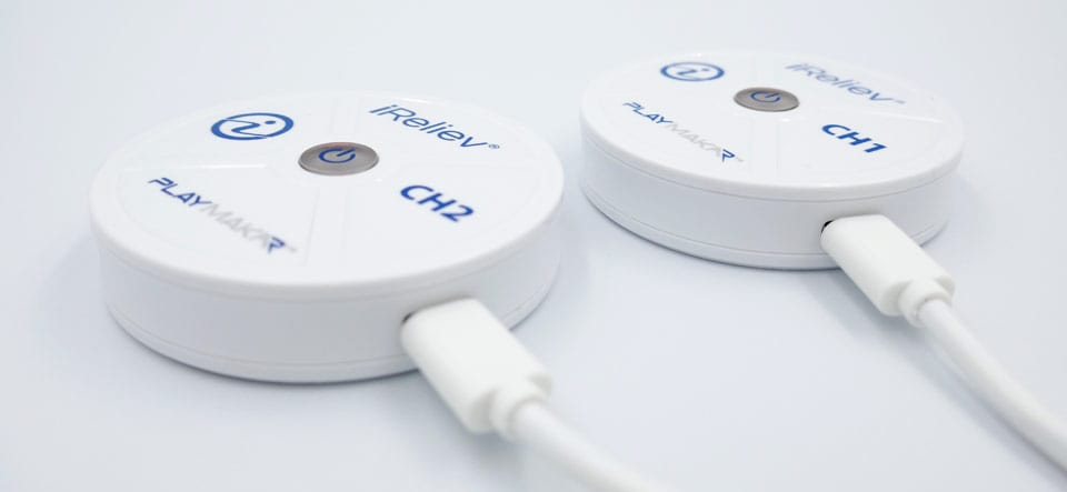 iReliev PlayMakar wireless receiver pods on charge